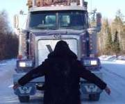 Highschool youth blocks logging trucks, Ontario, 2002